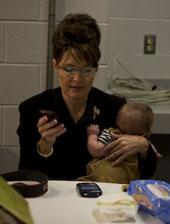 Sarah Palin using her BlackBerry