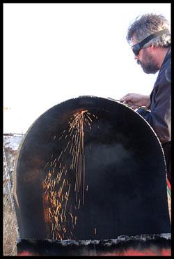 Image of man cutting barrel