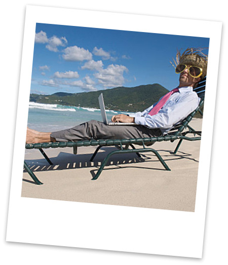 Remote worker with laptop on the beach