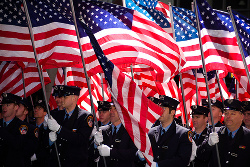 Military holding US flags