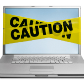 Laptop with caution tape