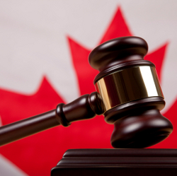 Gavel in front of a Canadian flag