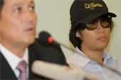 Wearing a baseball cap and sunglasses, Aekawit Thongdeeworakul appeared at a press conference in Bangkok