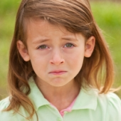 Young girl crying. Image from Shutterstock