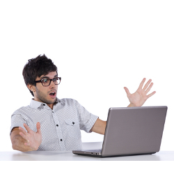 Shocked computer user courtesy of Shutterstock