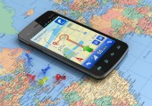 Phone on map, courtesy of Shutterstock