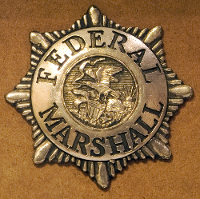 Federal Marshall badge courtesy of Shutterstock