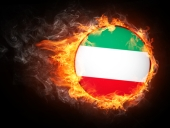 Iran flag in flames. Image courtesy of Shutterstock