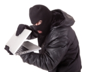 Burglar with computer. Image courtesy of Shutterstock