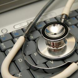 Stethoscope on a keyboard image courtesy of Shutterstock