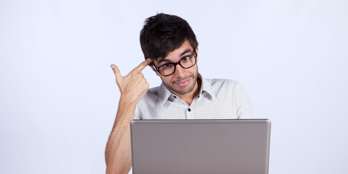 Man at computer. Image from Shutterstock