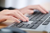 Fingers on keyboard, courtesy of Shutterstock