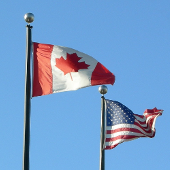 USA and Canadian flags flying together