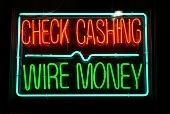 Wire money neon sign. Image from Shutterstock