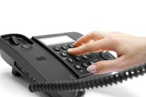 fingers dialling phone number