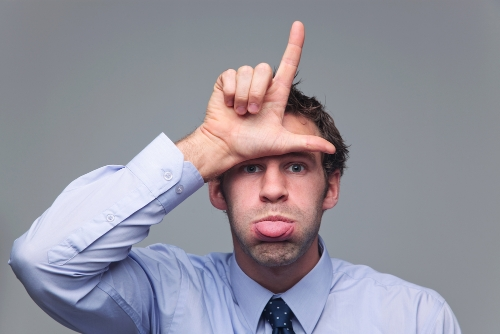 Loser sign, blowing raspberries. Image from Shutterstock