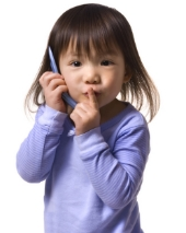 Young girl on phone. Image from Shutterstock