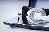 Headphones on laptop, courtesy of Shutterstock