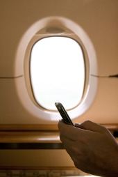 Phone and plane window, courtesy of Shutterstock