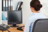 Woman at computer, courtesy of Shutterstock