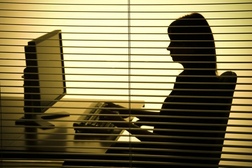 Woman at desk, courtesy of Shutterstock