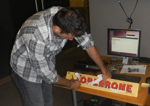 Onur opening up the jumbo Toblerone