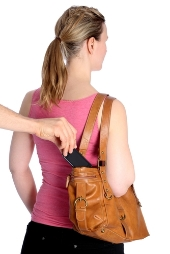 Pickpocketing a mobile phone. Image from Shutterstock
