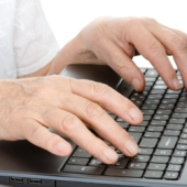 Elderly fingers typing. Image from Shutterstock