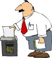 Man shredding paper, courtesy of Shutterstock