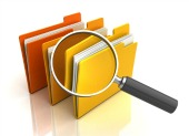 Magnifying glass on files. Image from Shutterstock