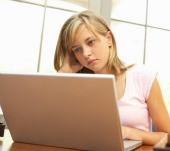 Teen on computer. Image from Shutterstock