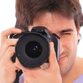 Man with camera, image courtesy of Shutterstock
