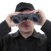 Man spying. Image courtesy of Shutterstock