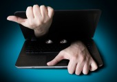 Spy on computer. Image courtesy of Shutterstock