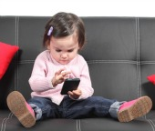 Child on smartphone. Image courtesy of Shutterstock.