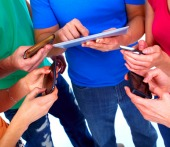 Group with smartphones. Image courtesy of Shutterstock