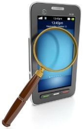 Magnifying glass and smartphone, image courtesy of Shutterstock.jpg
