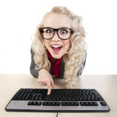Woman on computer, image courtesy of Shutterstock