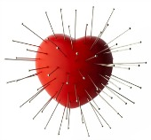 Heart with pins. Image courtesy of Shutterstock.
