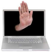 Hand and computer. Image courtesy of Shutterstock