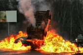 Car on fire, image courtesy of Shutterstock