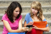 Kids on phone, courtesy of Shutterstock