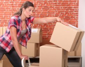shutterstock_womandroppingbox170