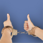 Thumbs up in handcuffs, image courtesy of Shutterstock