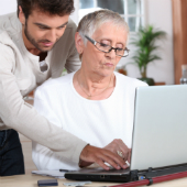 Image of people using computer courtesy of Shutterstock