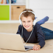 Image of boy on computer courtesy of Shutterstock