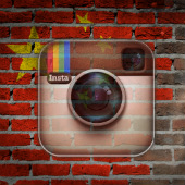 Image of China flag on brick wall courtesy of Shutterstock