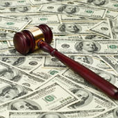 Image of gavel on money courtesy of Shutterstock