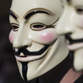 Anonymous masks courtesy of Shutterstock / Rob Kints