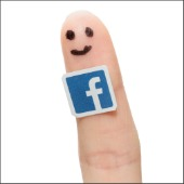 Facebook on finger. Image courtesy of scyther5/Shutterstock.com